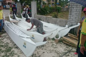 Delivering fishing boats to victims of Typhoon Yolanda